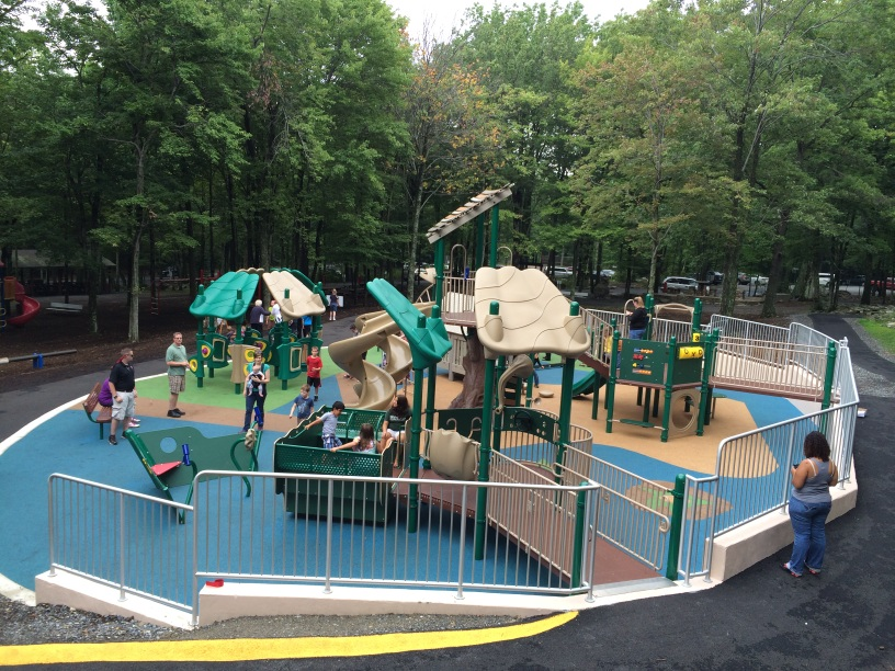 Child With Spinal Muscular Atrophy Cuts Ribbon At Opening of Unique Playground for Special Needs Children