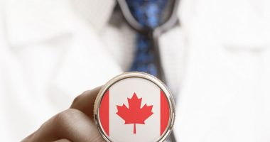 SMBA | SMA News Today | Research | Doctor holds a stethoscope showing Canadian flag